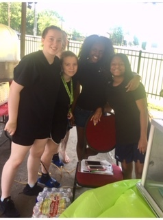 Our Girls Helping Quinch Thirsts at Field Day